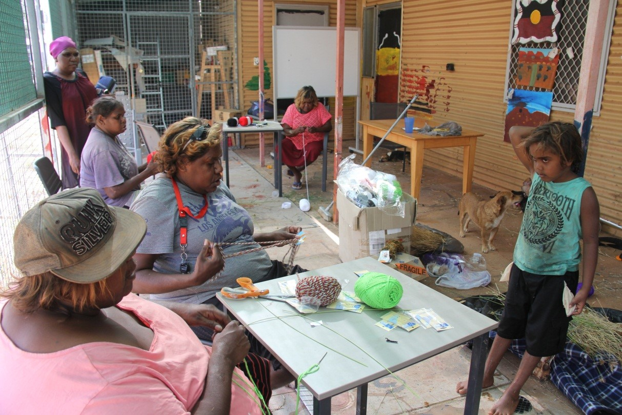 Valerie (front left) teaching the Irrungadji ladies to weave